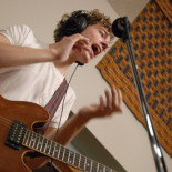 Lucas working on the hand claps and vocal with Born Ruffians in Session at Radio 3